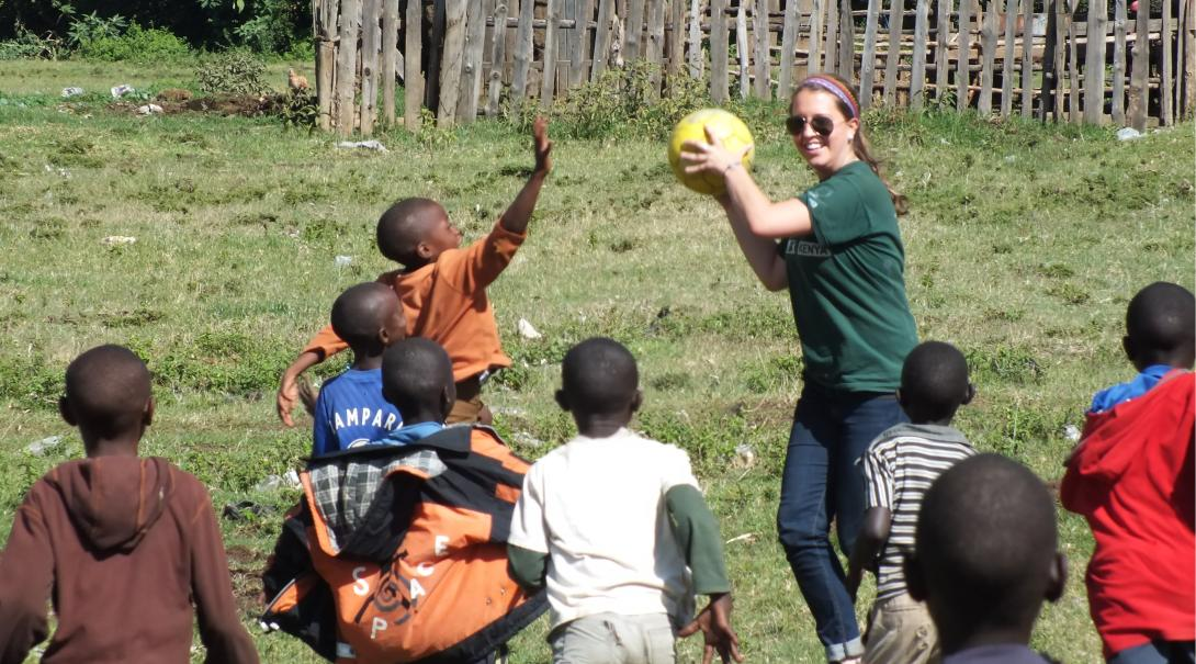 A teaching volunteers plays and practice physical activities with children in Kenya during her internship with Projects Abroad.